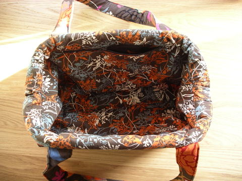 carpet handbag. the bag has an internal frame that pops open (and stays open) when you pull apart top edges of bag, and shut bring carpet handbag